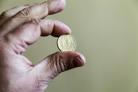 Coins in a hand lie as though last time photo