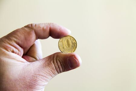 poverty relief: Coins in a hand lie as though last time Stock Photo