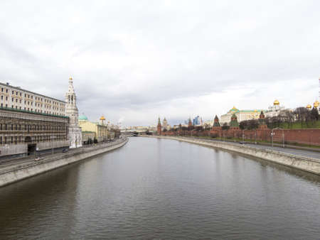 The embankment in the city in cloudy weather early in the morning photo