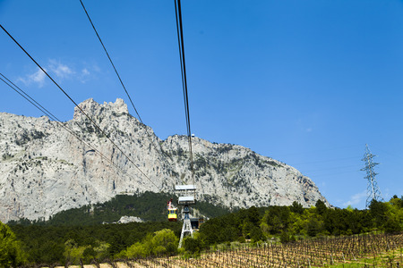 Ropeway on the high mountain in the sunny day photo