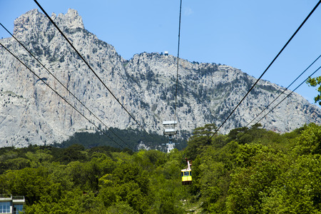 ropeway: Ropeway on the high mountain in the sunny day Stock Photo