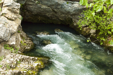 rifts: The mountain river quickly bears the waters through rifts