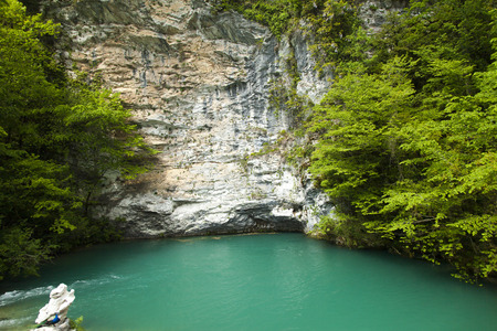 very cold: The blue lake lies highly in mountains and it very cold Stock Photo