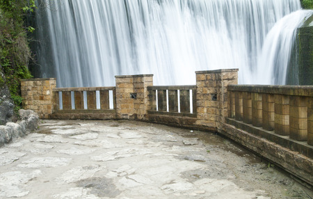 pleasing: The falls on the river are pleasing to the eye of all travelers and strongly rustle Stock Photo