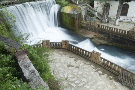 strongly: The falls on the river are pleasing to the eye of all travelers and strongly rustle Stock Photo