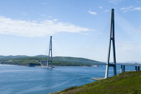 mackinac: A large suspension bridge over the blue sea under the blue sky