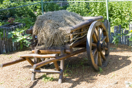cody: The old cart with hay stands in anticipation of the horse