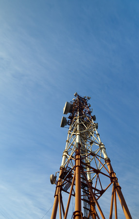 communication tower: Communication tower against the bright blue sky with clouds Stock Photo