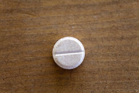 waited: The pill on a table is waited when accept them inside