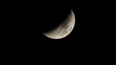 crescent: The bright crescent moon hangs over Earth all the time