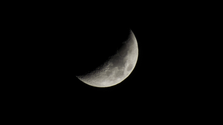The bright crescent moon hangs over Earth all the time