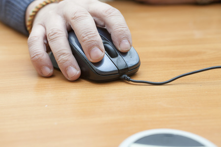 input device: The mouse on a table helps to operate the computer