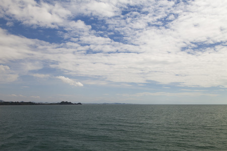 The day sea landscape casts melancholy, except for the ships