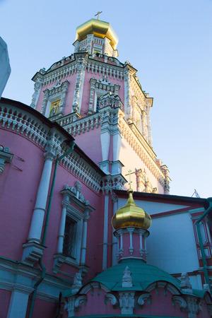 The beautiful orthodox church towers over neighboring buildings Stock Photo