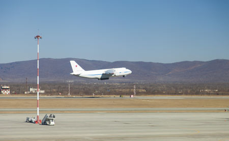 The big plane on take-off from airfield in the afternoon