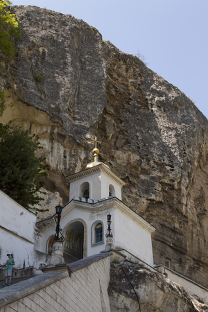 The orthodox church in mountains is constructed in a hard-to-reach spot