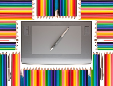 Professional plate on a white background among the colored pencils, pens and brushes