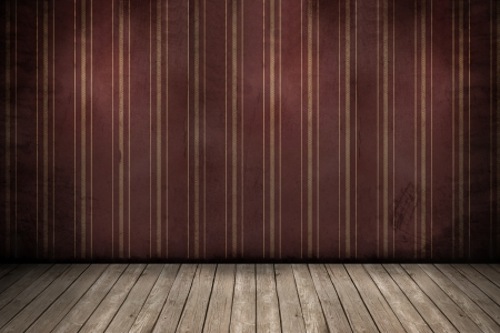 Wall with wallpaper and wooden floor inside an empty room