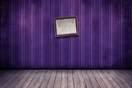 Wall with wallpaper and wooden floor inside an empty room photo