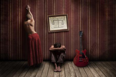 Between man and half-naked women guitar