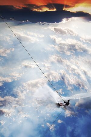Man moves on water skis in the sky  photo