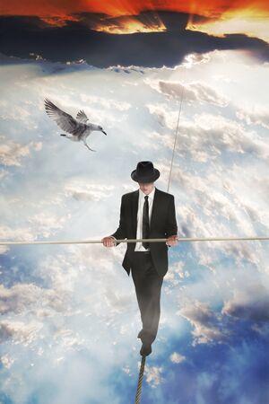 walking pole: Man walking on a high rope