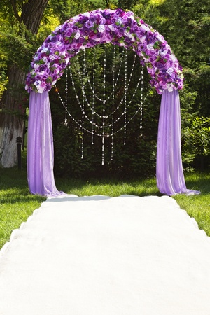 Wedding arch of purple roses