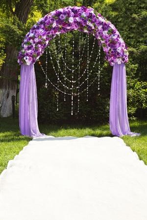 Wedding arch of purple roses