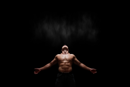 Image of strong man on a black background
