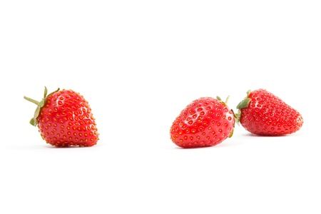 Background of ripe strawberries on white