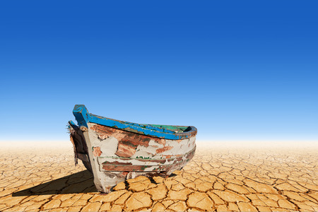 barren land: Old boat on dry land
