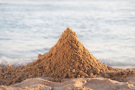 Mountain of sand on the beach