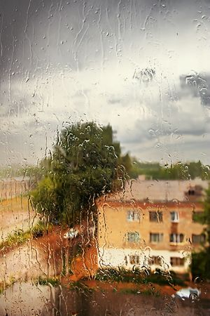 Summer. Weather and spoil a thunderstorm started. Heavy rain outside the window.