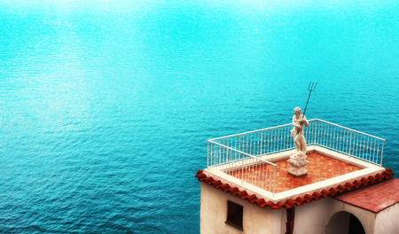 Marble sculpture of Neptune against the background of the sea. Place under the text.