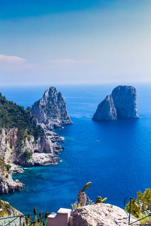Amazing Faraglioni cliffs panorama with the majestic Tyrrhenian sea in background, Capri island, Campania region, Italy, Europe. Stock Photo - 106225140