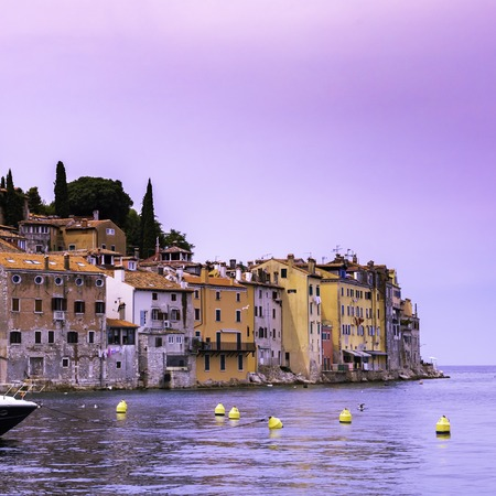 View from the sea on the coast of the old town of Rovinj with colorful houses at sunset, Croatia Stockfoto - 106225144