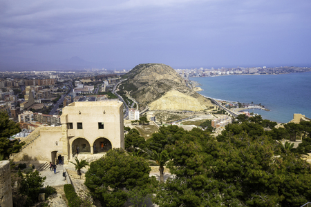 Wide angle view of Alicante, Spain from Santa Barbara Castle. Panoramic view of the city, the harbor and the hills. Place to visit citizens and tourists. Stock Photo