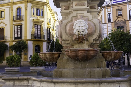 Closeup of a fountain in the square of Virgen de los Reyes and the Archbishop