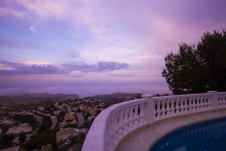 View of pool villas on the Costa Blanca at sunset, Spain. Real estate spain