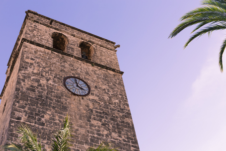 The bell tower of Saint Bartholomew church in the old town of Xabia, also known as Javea, in Spain