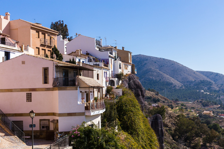 The facades of the white houses of the Spanish old town of Finestrat are built in the mountains.