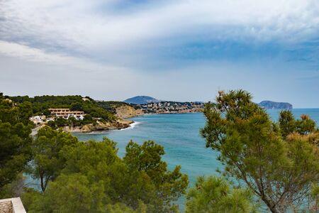 Panoramic view of Moraira Playa El Portet in Mediterranean Alicante, Spain.