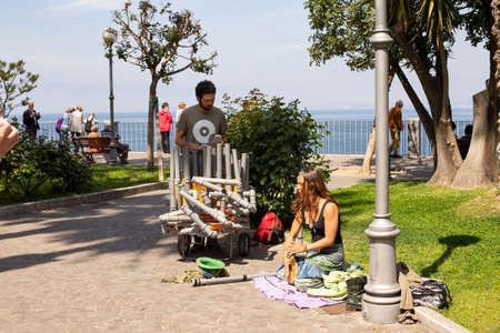 Sorrento, Gulf of Naples, Italy - April 11, 2017: street musicians play on plastic pipes on the promenade of the Neopolitan Gulf of Sorrento, Italy