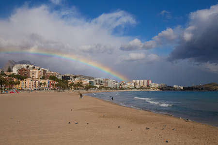 Rainbow over the old town of Villajoyosa with colorful houses, mountains and the sea, Spain