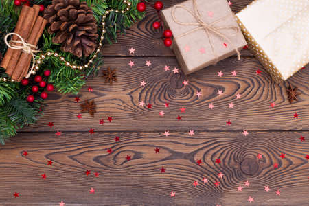 Christmas or New Year background, plain composition made of Xmas decorations and fir branches, flat lay, blank space for a greeting text.