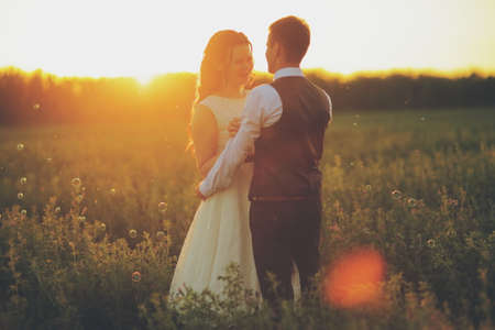Happy bride and groom hug each other. Wedding. Happy love concept. High quality photo