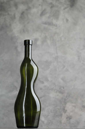 Wine bottle on a concrete background. Free space for inscription. 版權商用圖片