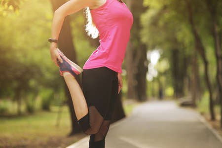 The young woman is engaged in sports fitness in nature forest Healthy fit living