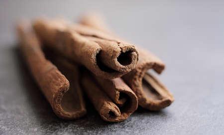 Scented cinnamon sticks on gray concrete countertop. High quality photo Reklamní fotografie
