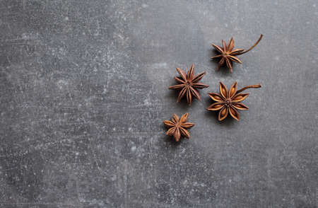 Fragrant star anise stars on a gray concrete countertop. High quality photo
